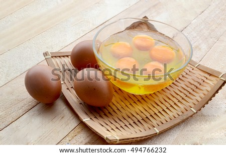 egg crack and un-crack  on wooden background
