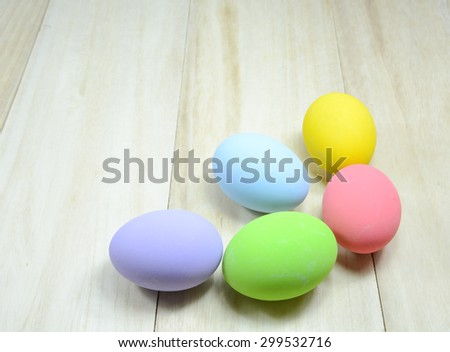 Egg decorated on wood background