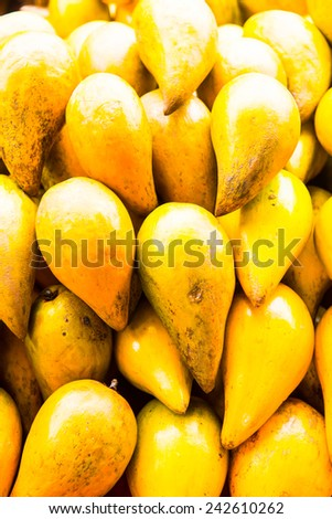 Egg fruit or Canistel on sale stand, Thailand.