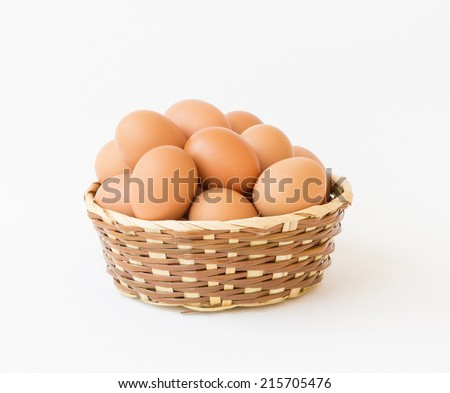 egg in basket  wicker on white background