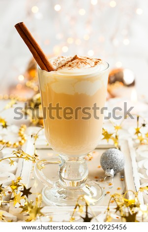 Egg Nog with Cinnamon Sticks - stock photo