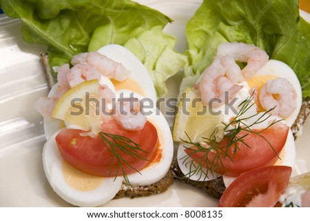 Egg  open sandwhich. Typical danish and scandinavian open type sandwhiches on white plate. Normally eaten for lunch. - stock photo