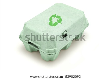 Egg paper carton with recycle symbol in green - stock photo