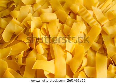 Egg pasta Pappardelle close up background