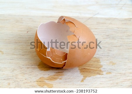 stock photo egg shells on the wooden floor 238193752 Ginger And White Coffee Three Biscuits Stock Photo Image