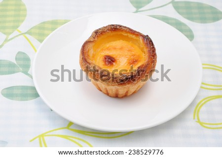 egg tart cheese pie on a plate on table cloth - stock photo