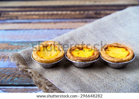 Egg tart custard sweet delicious dessert.Dessert snack made from pie egg.Egg tart have a custard cream sweet put on top of bakery.  - stock photo