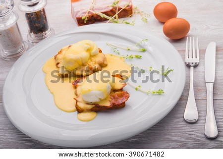 egg with bacon on white dish in restaurant - stock photo