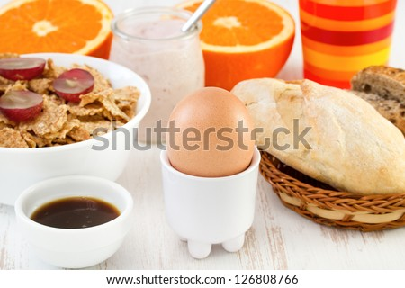 egg with cereals, bread and juice