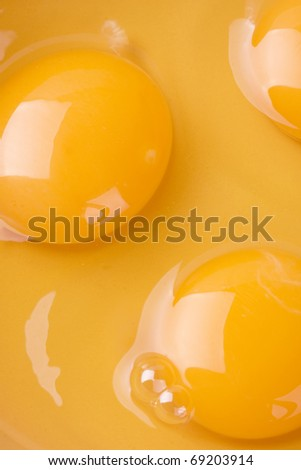 Egg yolk closeup background - stock photo