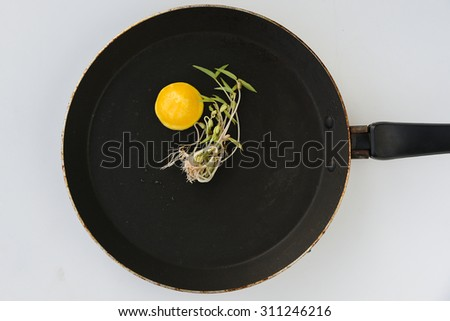 Egg yolk on a hot skillet or non-stick pan or frying pan with green gram sprouts, oil free cooking,break fast , home made food, kids snack,food art, egg yellow ,half boiled, bullseye egg recipe - stock photo
