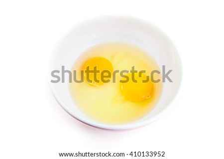 Egg yolks raw in a bowl  top view on  white background. - stock photo