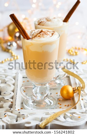Eggnog with Cinnamon Sticks - stock photo