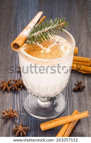 Eggnog with Cinnamon Sticks - stock photo