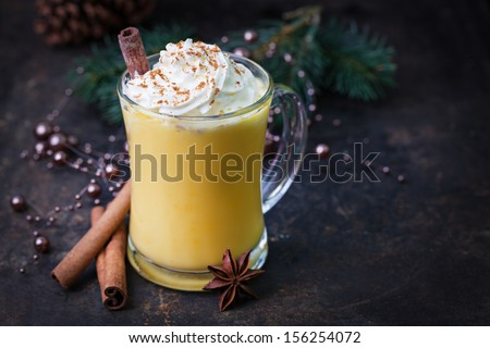 eggnog with whipped cream and cinnamon