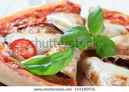 Eggplant and cheese pizza  - stock photo