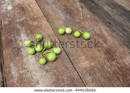 eggplant fresh organic green vegetable on wooden background - stock photo