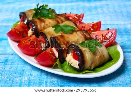 eggplant rolls. - stock photo