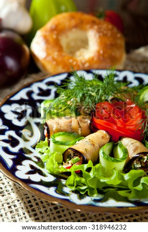 Eggplant Rolls with Tomatoes, Cheese and Cucumber - stock photo