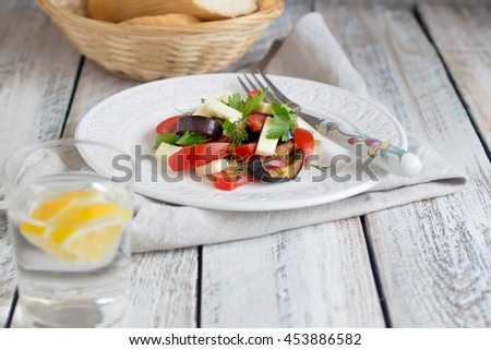 Eggplant salad with tomato and cheese. Concept of healthy eating. Place for text. - stock photo