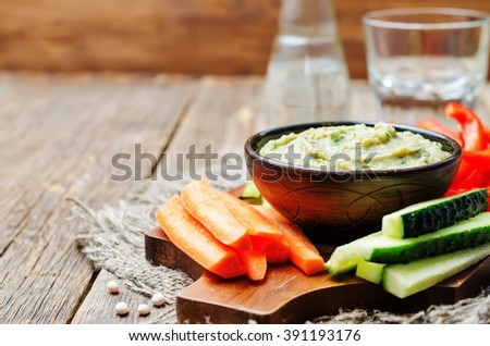 eggplant White bean dip with vegetables. toning. selective focus - stock photo