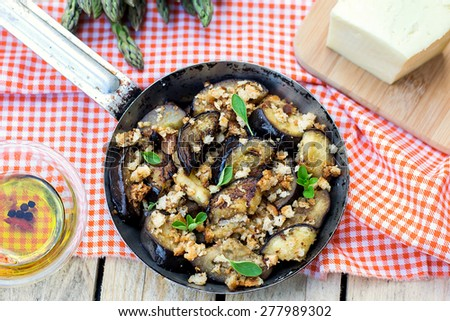 Eggplants aubergines sauteed and pan-fried with breadcrumbs and cheese. Selective focus, shallow depth of field - stock photo