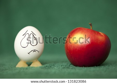 Eggs and apple. - stock photo