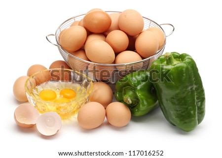 eggs and fresh green paprika  on white background
