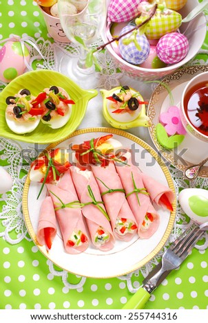 eggs and ham rolls stuffed with cheese and vegetables for easter breakfast - stock photo