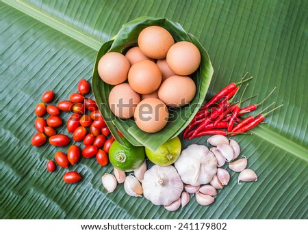 Eggs and mixed vegetables and spices - stock photo