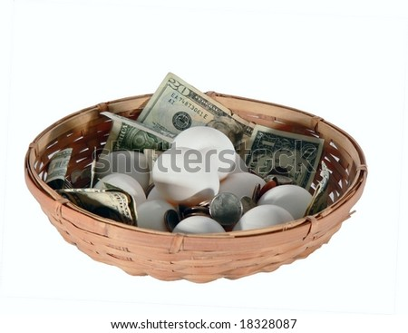 Eggs and money all in a basket isolated on white. Concept of putting all your eggs in one basket as a financial or retirement strategy that not recommended. US currency using dollars and coins.  - stock photo