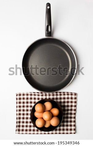 Eggs and pan on isolated background - stock photo