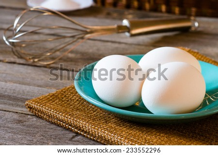 eggs and whisk on the table - stock photo