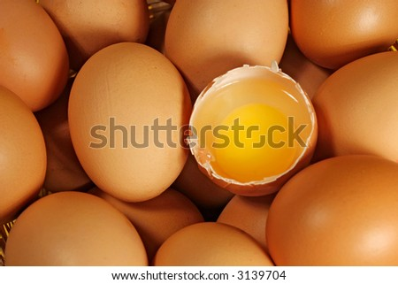 Eggs background (Eggs with one of them cracked) - stock photo