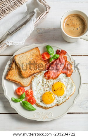 Eggs, bacon and toast for breakfast - stock photo