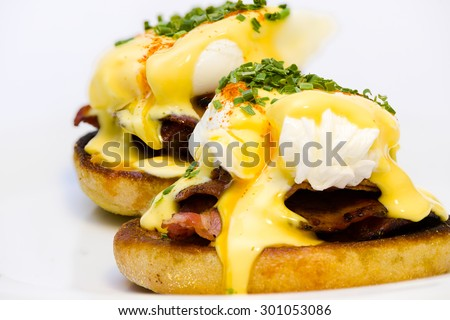Eggs Benedict on toasted muffins with bacon and sauce