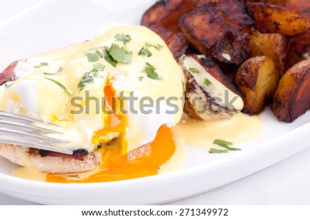 eggs benedict with farm fresh eggs and ham and fried potatoes