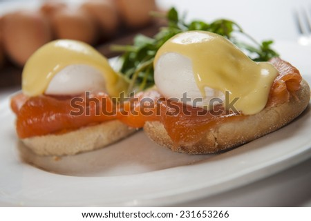 Eggs Benedict with Smoked Salmon and Muffin - stock photo