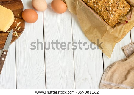 Eggs, Cheese and Homemade Gluten free Sweet Bread in the Baking Dish on a Light White Wooden Background. Rural Kitchen or Bakery - Background with Free Text Space, Horizontal - stock photo