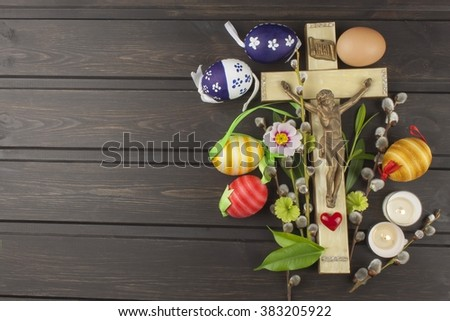 Eggs Christian Easter symbol. Preparation for Easter celebrations. Wooden cross with Christ. Resurrection, celebration of the coming of the savior. Painted eggs, spring celebration. - stock photo