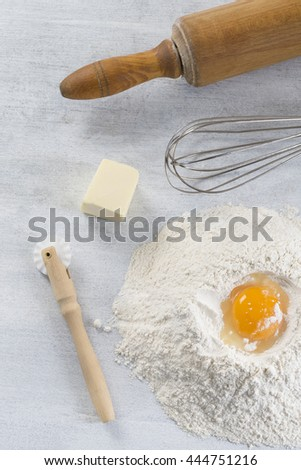 eggs, flour, butter and kitchen utensils - stock photo