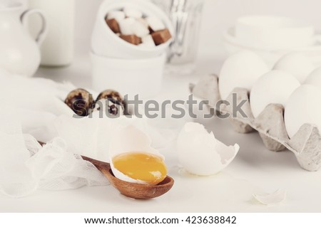 eggs flour milk butter and kitchen utensils .Toned photo - stock photo