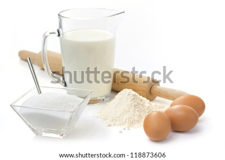 eggs, flour, sugar,  milk  and rolling pin - stock photo