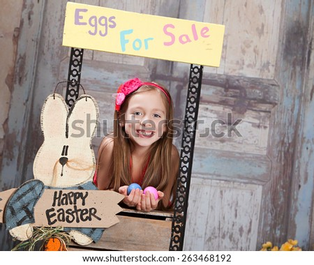 Eggs for Sale.  Attractive young girl selling Easter Eggs.  Room for your text. - stock photo