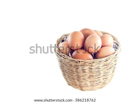 Eggs in a basket isolated on white background