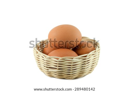 Eggs in a basket on white background