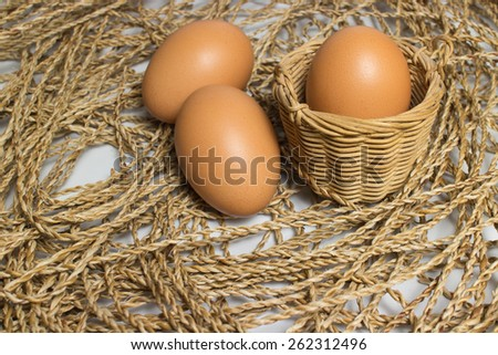 Eggs in a basket placed on the ropes. - stock photo