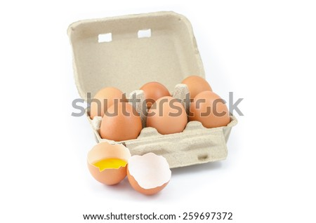 Eggs in a grey paper box on white background - stock photo
