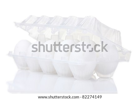 eggs in package is isolated on white - stock photo