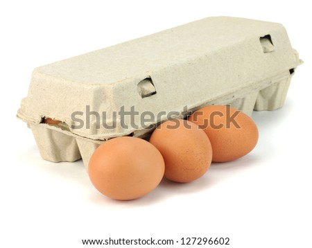 Eggs in paper box on a white background - stock photo